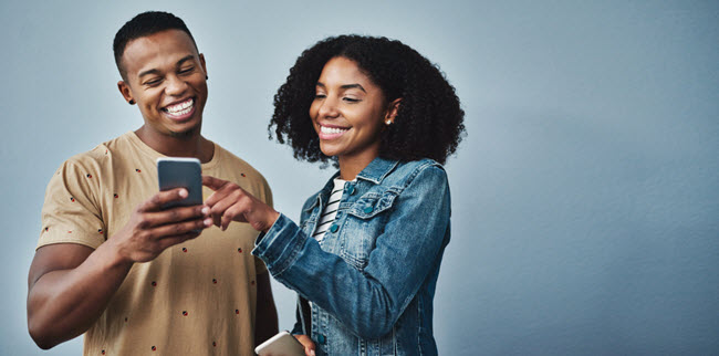 Man and Woman looking at cell phone
